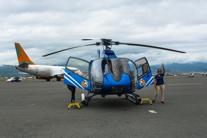 Blue-Hawaiian Helicopter is ready for the tour flight stock photography