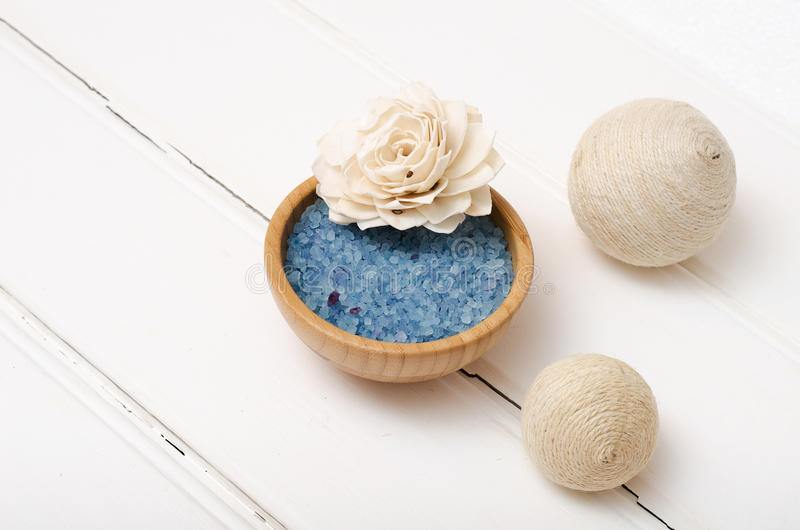 Blue healing sea salt on the white boards royalty free stock image