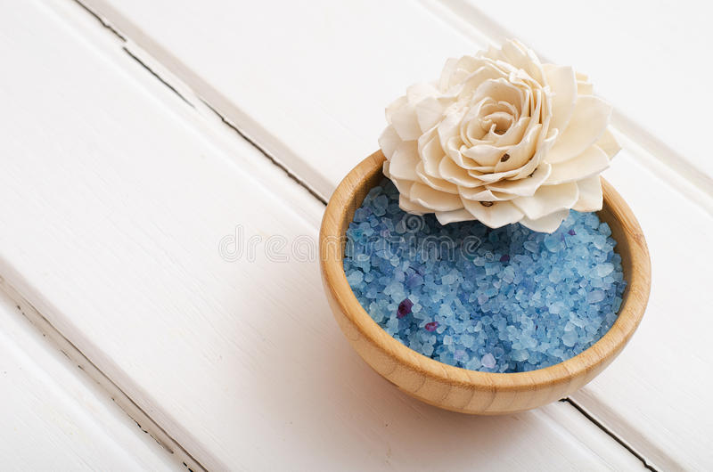 Blue healing sea salt on the white boards royalty free stock photos