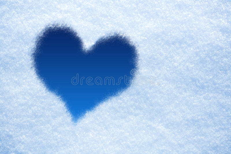 Blue Heart from ice on snow background. Heart from ice on snow background stock photography