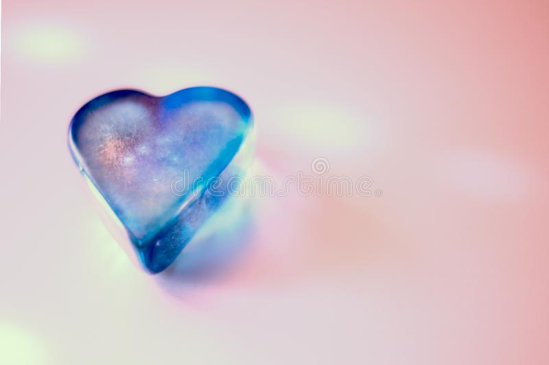 Blue heart on pink royalty free stock photography