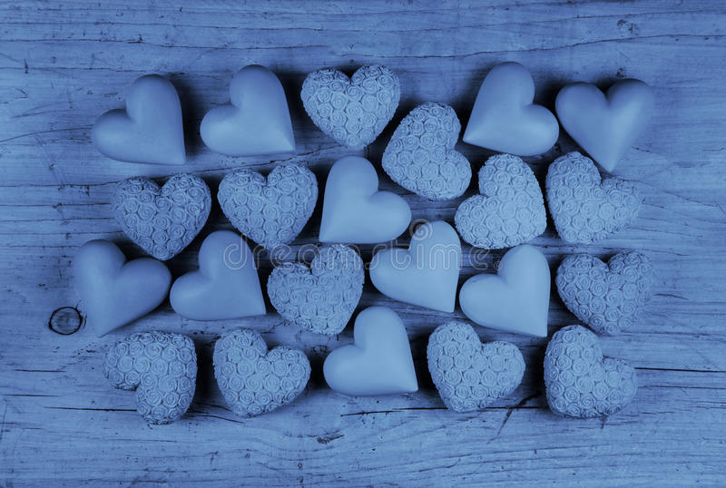 Blue hearts on an old wooden background: greeting card for fathers day. royalty free stock photos
