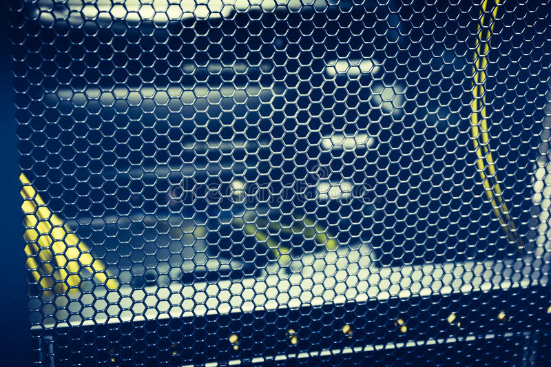 Blue Hexagon Metal Protective mesh on Network Server Equipment. Technology and hardware electronic royalty free stock image