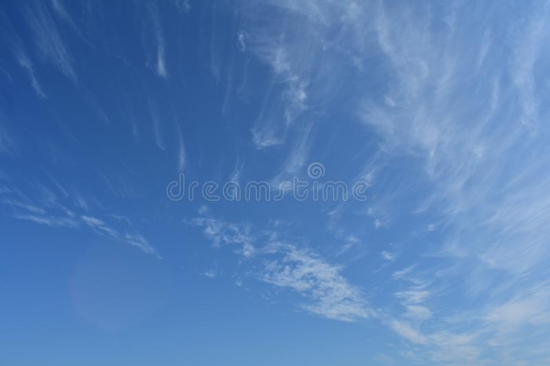 Blue high clear sky light lush transparent white clouds summer royalty free stock photography