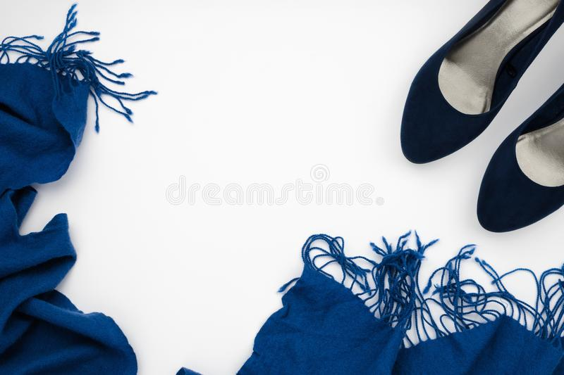 Blue high heeled shoes and blue scarf, fashion concept. Flatlay frame arrangement with blue high heeled shoes and blue scarf, fashion concept, white background royalty free stock photos