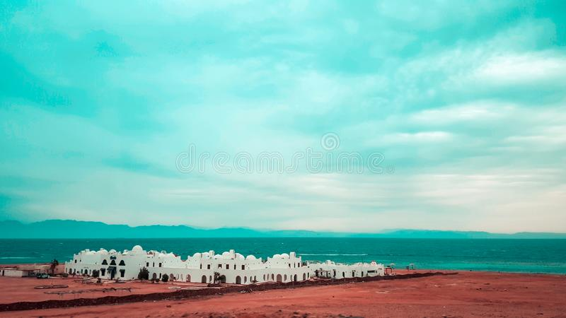 Blue hole dahab diving deaths. Egypt, seashore, sand, building, buildings, architects, architecture, bedouin, exotic, africa, sky, cloud, clouds, cloudy stock images