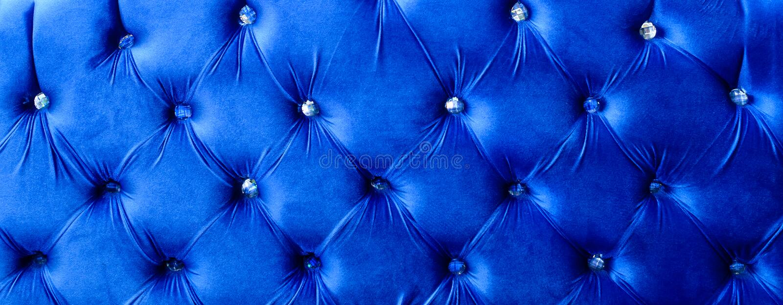 Blue horizontal elegant leather texture with buttons for background and design stock photo