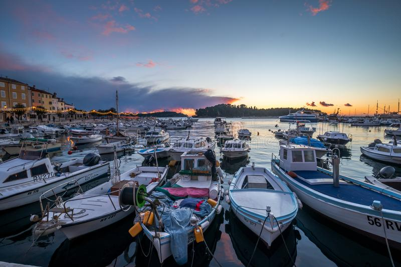 Blue Hour with boats  by The Sea in Rovinj. Beautiful blue Hour by The Marina with boats in Rovinj, Croatia, Europe on Winter evening. Photographed with D750 stock images