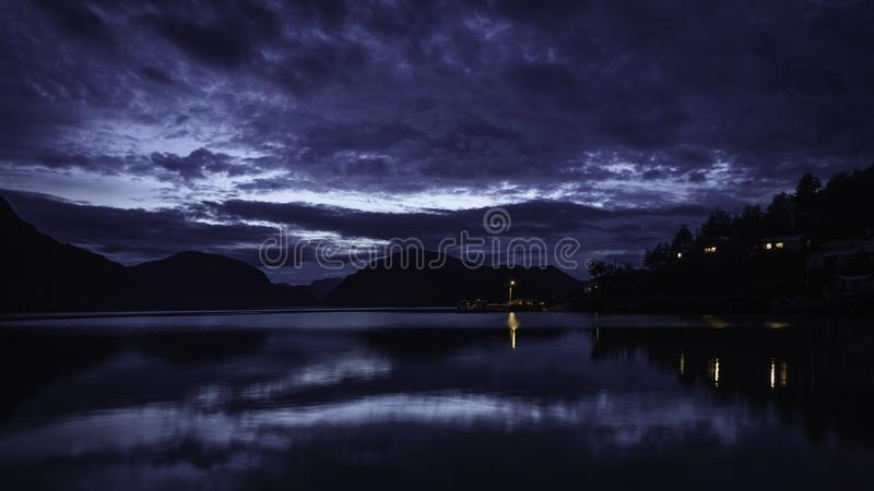 Blue hour in the dock of Caleta Tortel. The Pacific ocean coast can be appreciated. stock photo