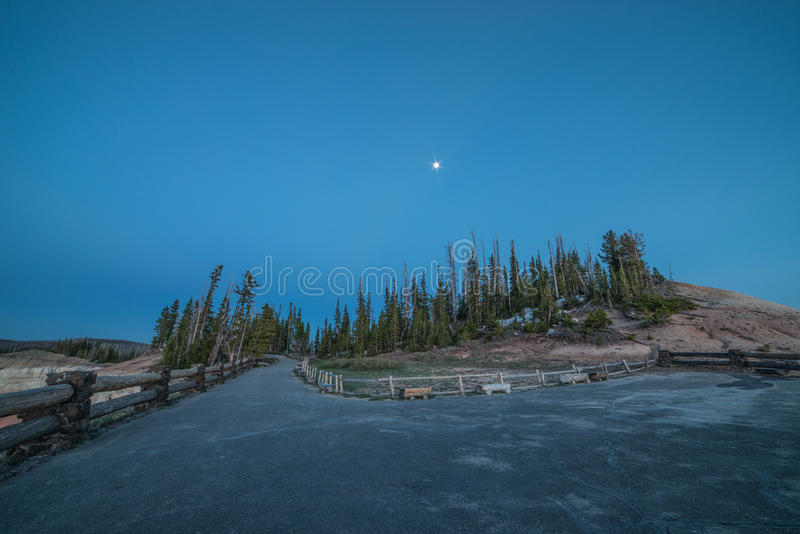 Blue Hour, Forest Trees, and Moonrise on Point Supreme View Point, Cedar Breaks National Monument, Utah royalty free stock photos