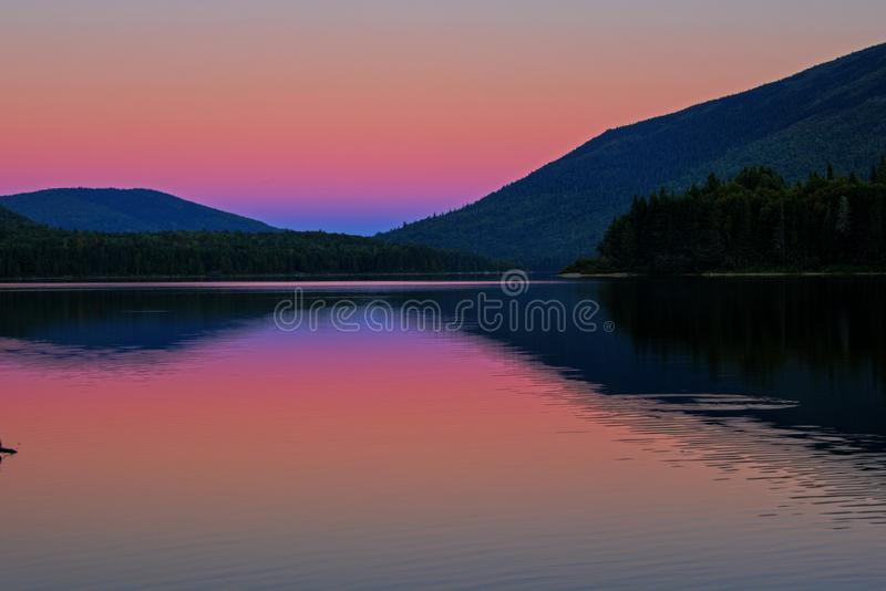 Blue Hour Light On Big Nictau Lake. Looking across Big Nictau Lake at Mount Sagamook in Mount Carleton Provincial Park. The location is in the wilderness of stock photo