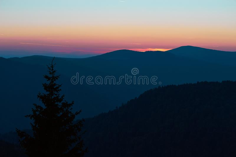 Blue hour with Mountain View. Mountain view in Parang Carpathians, Romania at sunset. Blue hour. Color contrast. Single tree in the foreground stock image