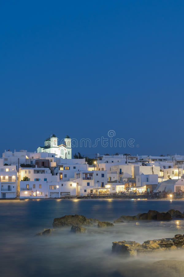 Blue hour of Naoussa village at Paros island in Greece showing the beautiful local church. royalty free stock photography