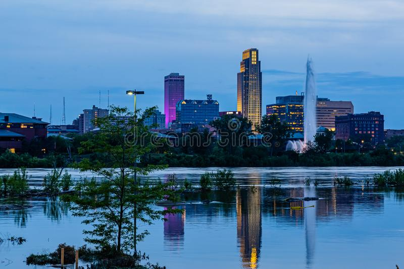 Blue hour Night scene of reflections of buildings in 2019 Missouri River flooding of Harrah`s Casino parking lot in Council Bluffs. Blue hour Night scene of royalty free stock images