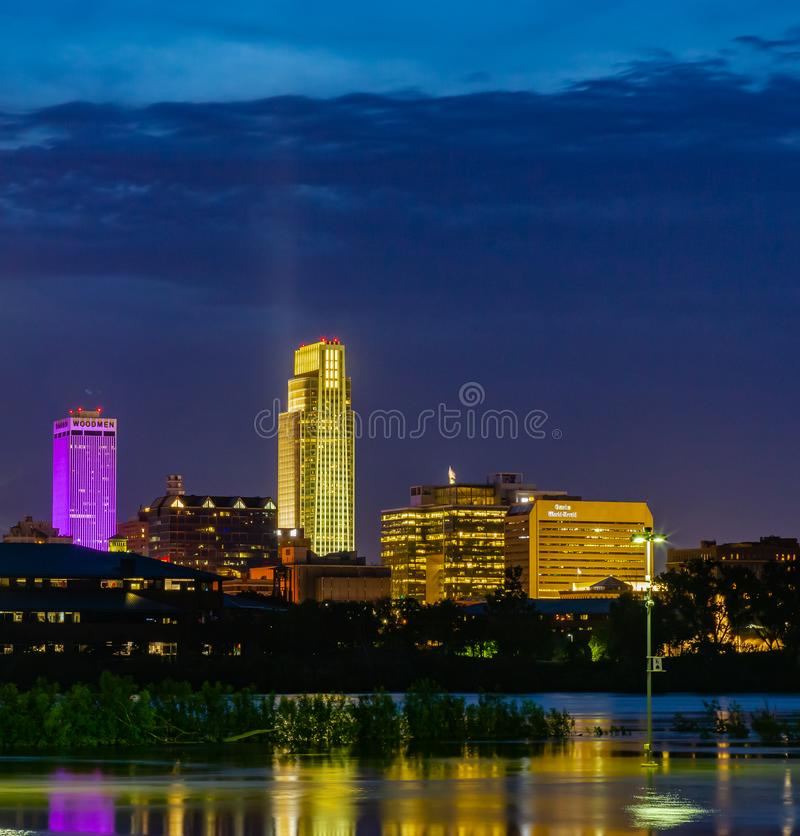 Blue hour Night scene of reflections of buildings in 2019 Missouri River flooding of Harrah`s Casino parking lot in Council Bluffs. Blue hour Night scene of royalty free stock photography