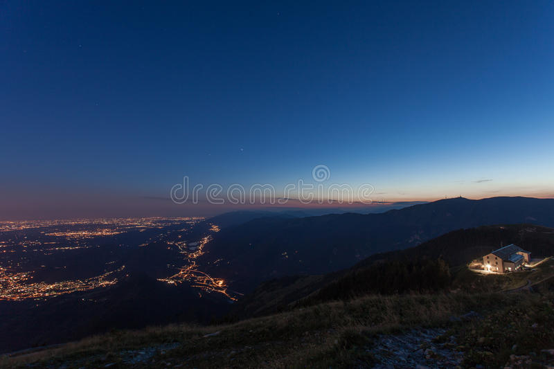 Blue hour and nigth incoming on venetian prealps royalty free stock photography