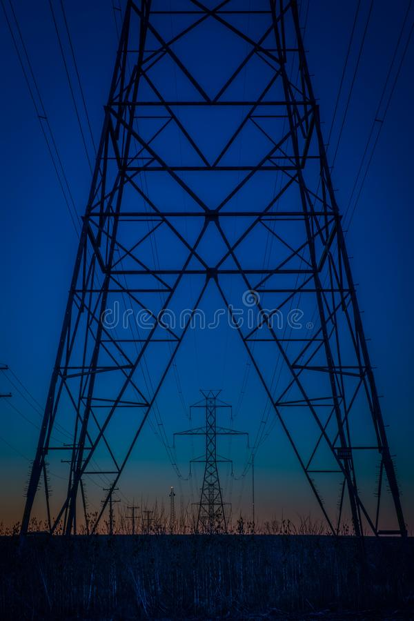 Blue hour power line towers stock image