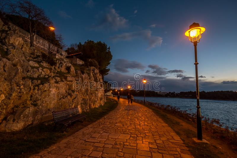 Blue Hour by The Sea in Rovinj. Beautiful blue Hour by The Sea in Rovinj, Croatia, Europe on Winter evening. Photographed with D750 stock images