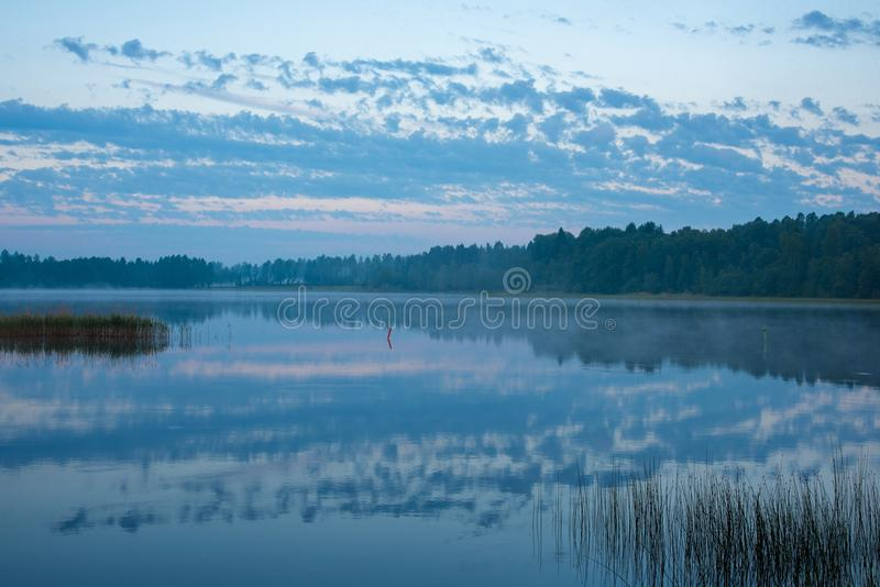 Blue hour sky and lake in dawn. In Sweden june 2018 stock image