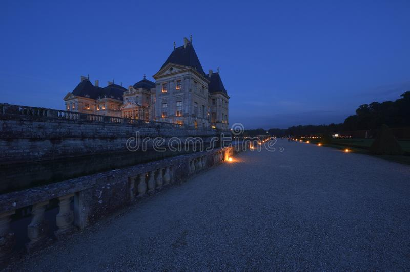 Castle of Vaux-le-Vicomte - Paris region. During the blue hour, there are magnificent lights on the castle of Vaux-le-Vicomte stock images