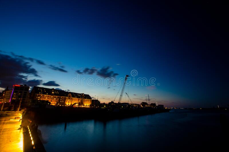 Blue hour view of old historical buildings in Copenhagen royalty free stock photos