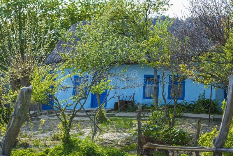 Blue house in Danube delta, Romania stock images