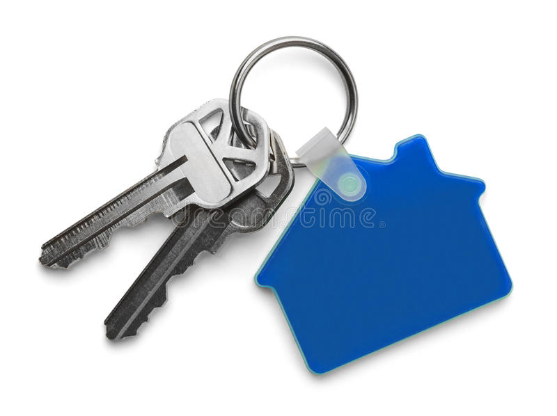 Blue House and Keys. House keys with Blue House Keychain Isolated on White Background royalty free stock image