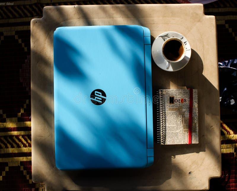 Blue Hp Laptop Near Notebook royalty free stock photo