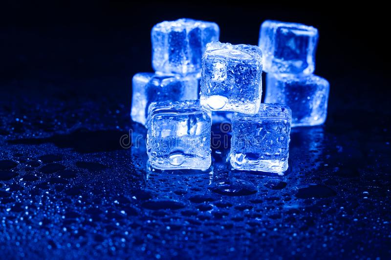 Blue ice cubes on black background. Blue  ice cubes on black background, alcohol, alcoholic, amber, bar, beverage, bottle, bourbon, brandy, brown, close-up royalty free stock images