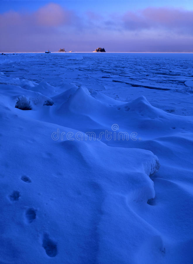 Blue ice floating royalty free stock photography