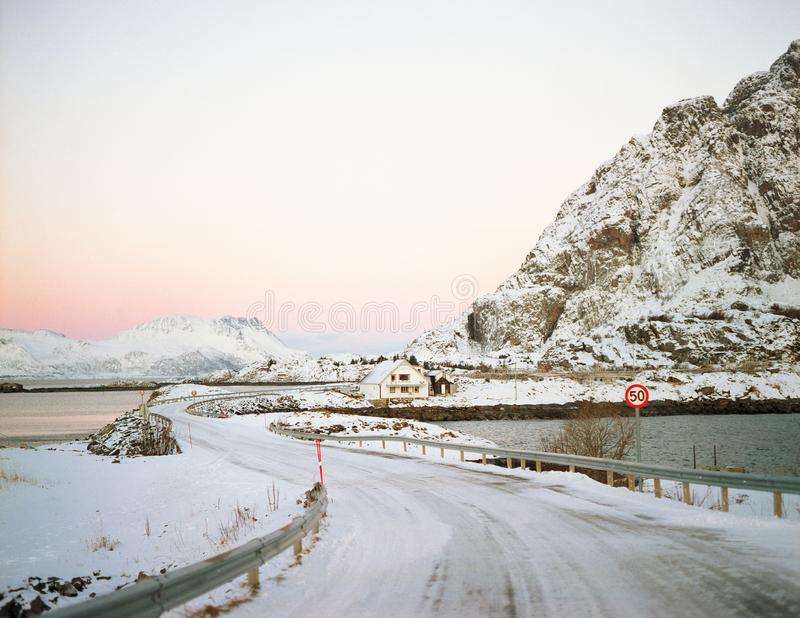 Blue ice of the frozen lake at morning. Winter landscape on the mountains and frozen street royalty free stock photos