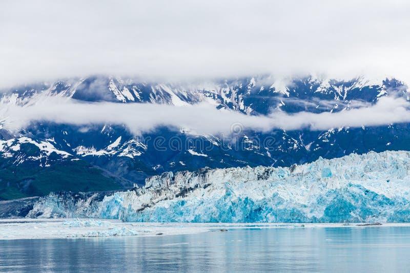 Blue Ice of Hubbard Glacier. Hubbard Glacier in Alaska under Cloudy Skies royalty free stock images