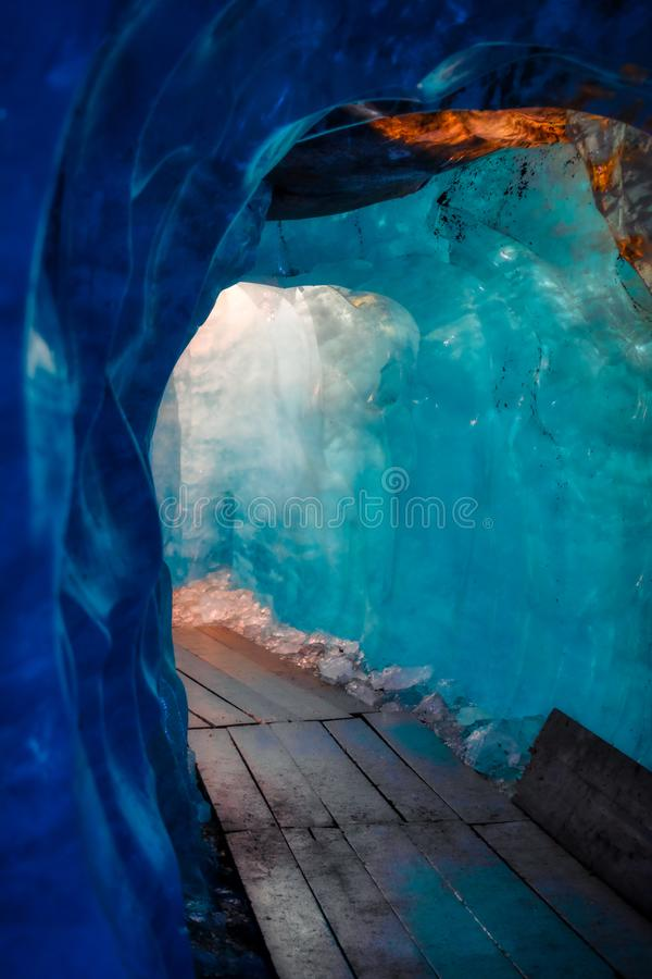 Blue ice inside a cave under melting rhone glacier royalty free stock image
