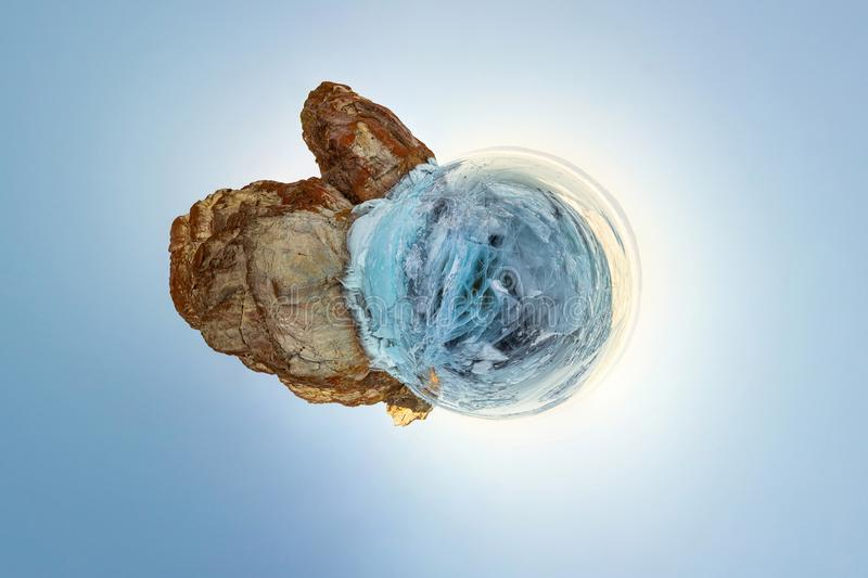 Blue ice of Lake Baikal, the cliffs of the island of Olkhon. Tiny planet 360vr panorama royalty free stock photography