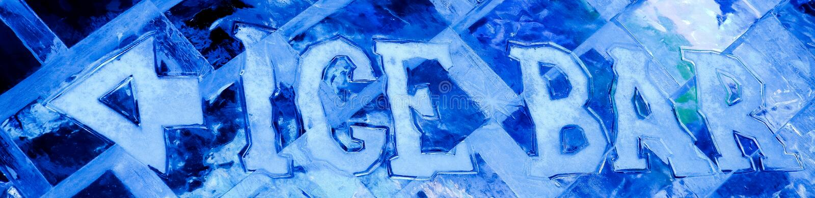 Blue ice sculpture with text ice bar and arrow. On ice wall stock photos