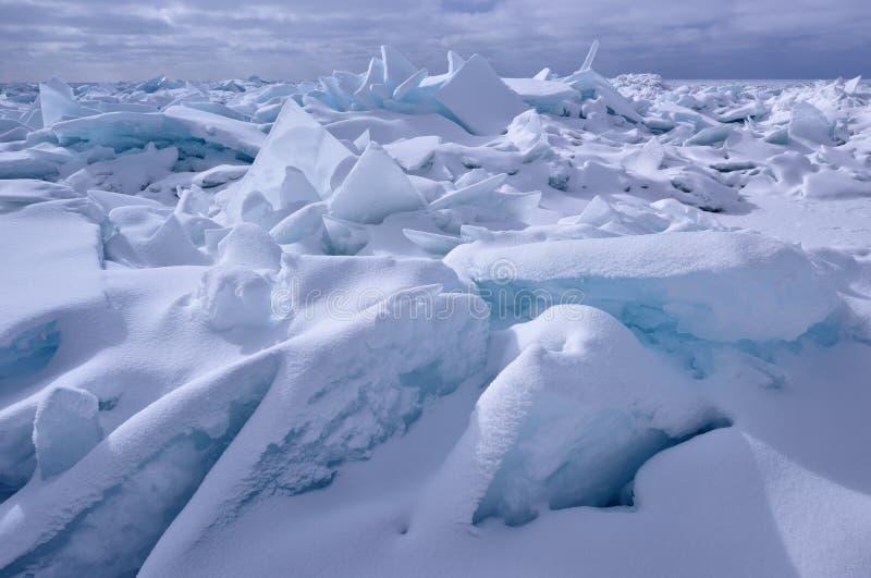 Blue Ice Shards, Lake Michigan. Landscape of blue ice shards and snow covered shoreline of Lake Michigan, Sleeping Bear Dunes, Michigan, USA stock photos