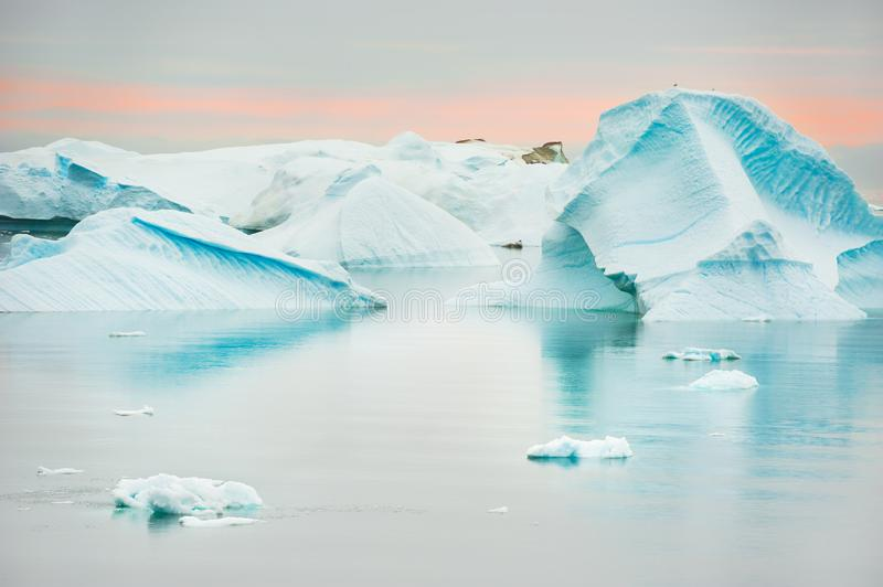 Blue icebergs on the shore of Atlantic ocean in Greenland. Blue icebergs on the shore of Atlantic ocean, western Greenland royalty free stock image