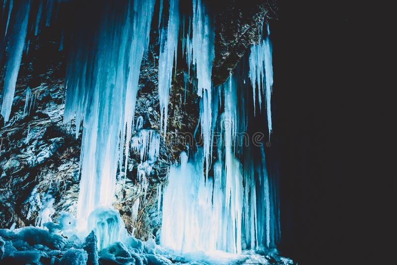 Blue icy on rocks at night. Beautiful winter landscape. Blue icy on rocks at night. Beautiful winter stock photography