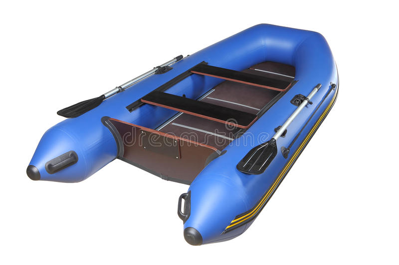 Blue inflatable boat with oars, plywood deck and seats. Dark blue, sport inflatable boat for recreation and fishing, with oars, plywood floors and mahogany stock photo