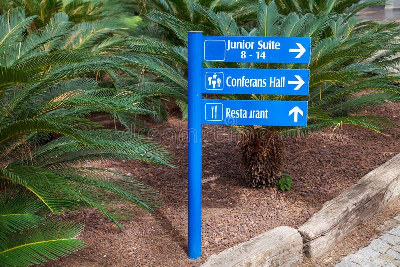 Blue information signs on the direction of the park area in the hotel royalty free stock images