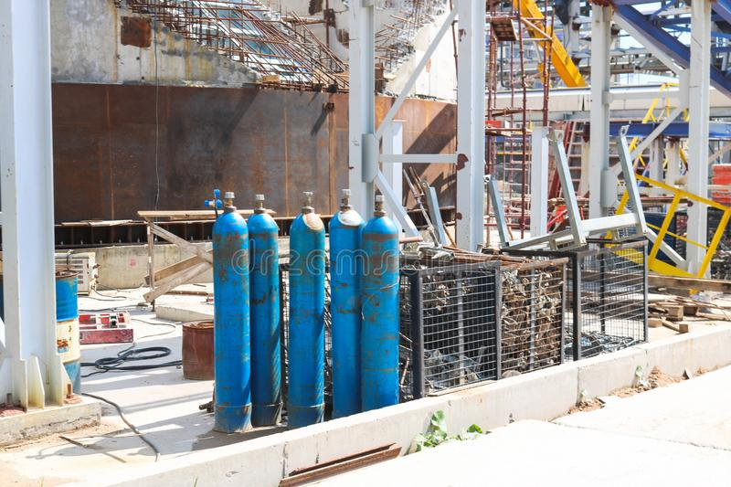 Blue iron metal cylinders with liquefied gas oxygen oxygen air helium argon for welding at the refinery petrochemical plant. Blue iron metal cylinders with stock photo