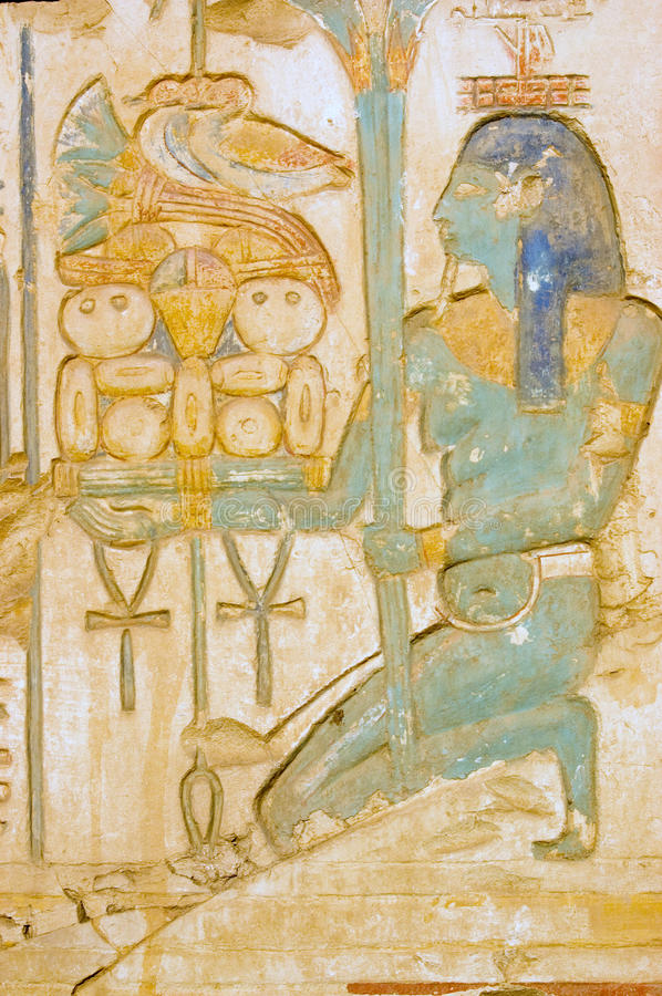 Blue Isis goddess with food tray stock images
