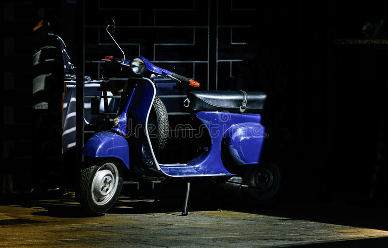blue italian scooter outside italian restaurant royalty free stock images