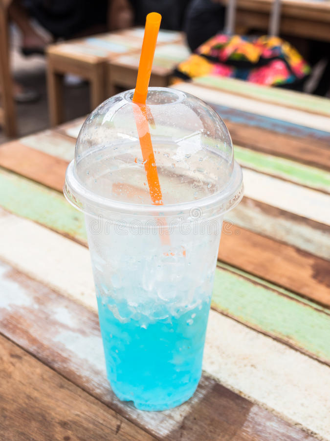 Blue italian soda in plastic cup. With ice royalty free stock photography
