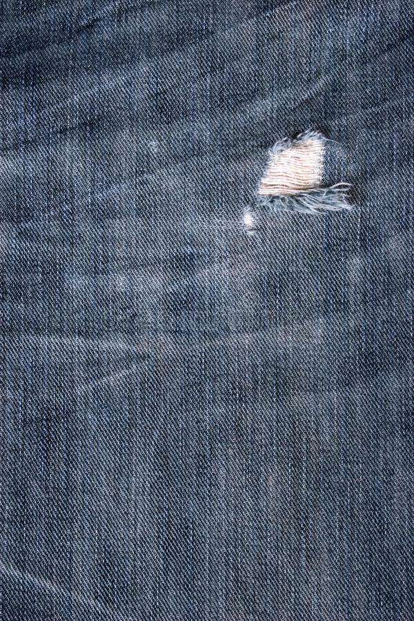 Blue Jean Texture With Hole Stock Image