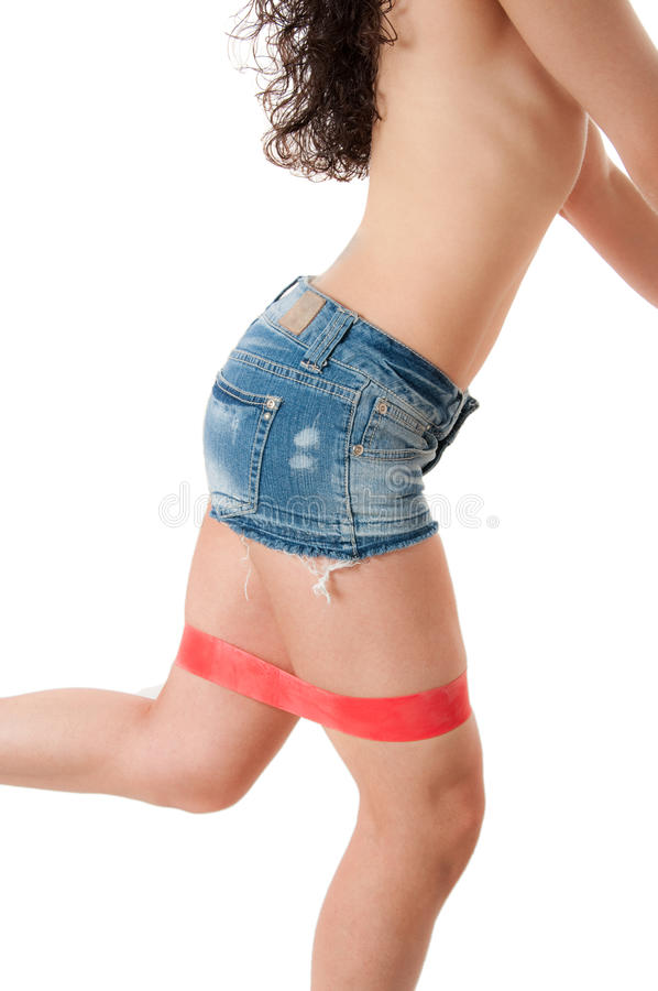 Blue Jeans. Model wearing blue jeans shorts working out over white background stock image