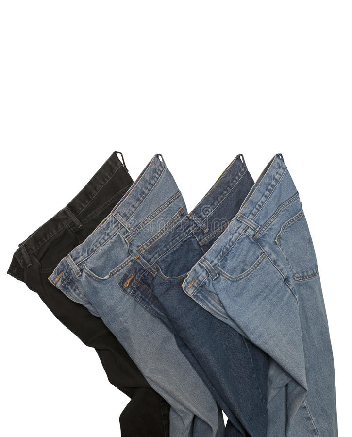 Blue Jeans. Four Pair Of Blue Jeans Isolated On A White Background stock images