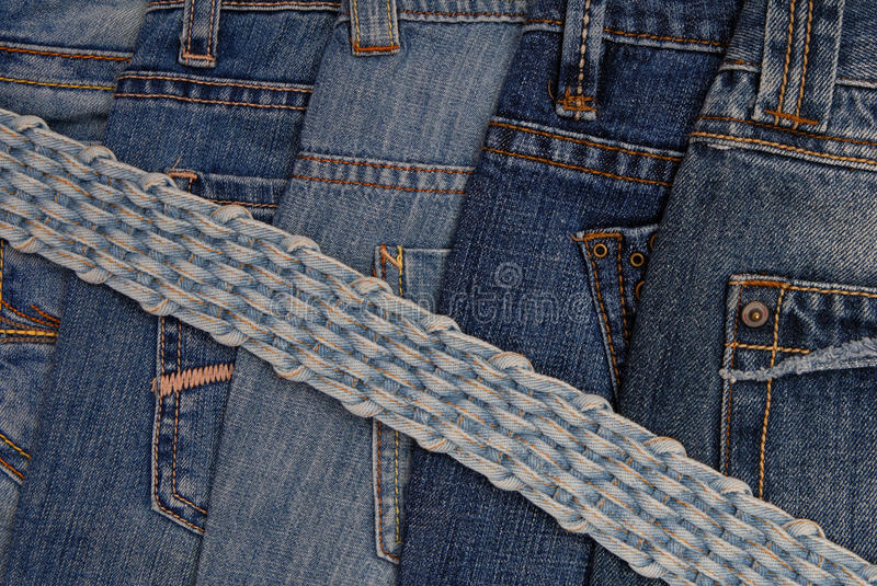 Blue jeans and braided belt royalty free stock images