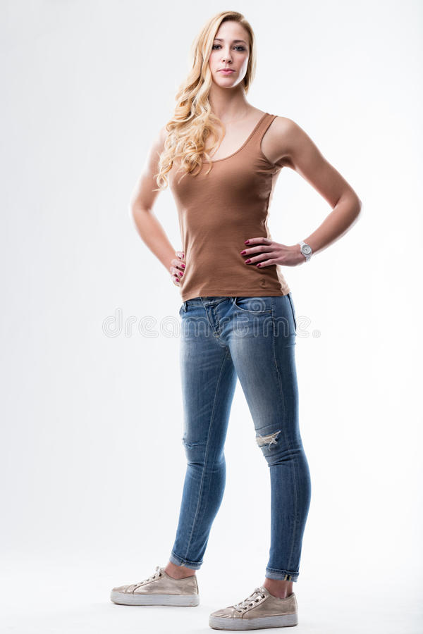 Blue jeans and brown underskirt woman royalty free stock image