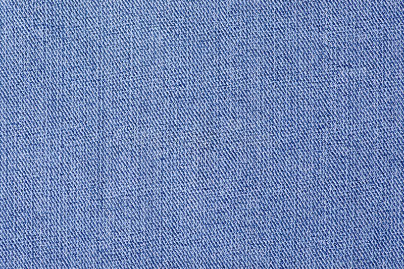 Blue jeans fabric cloth material texture textile. Macro blur background stock images